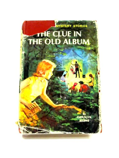 The Clue In The Old Album by Carolyn Keene