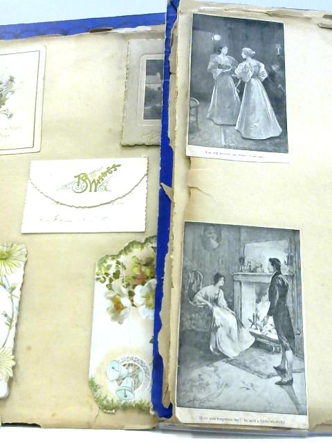 Vintage Pictorial Album of Christmas cards and newspaper cuttings. by Unknown